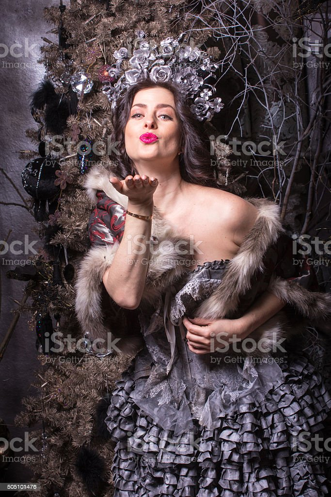 Christmas concept. Pretty woman in carnival dress. stock photo