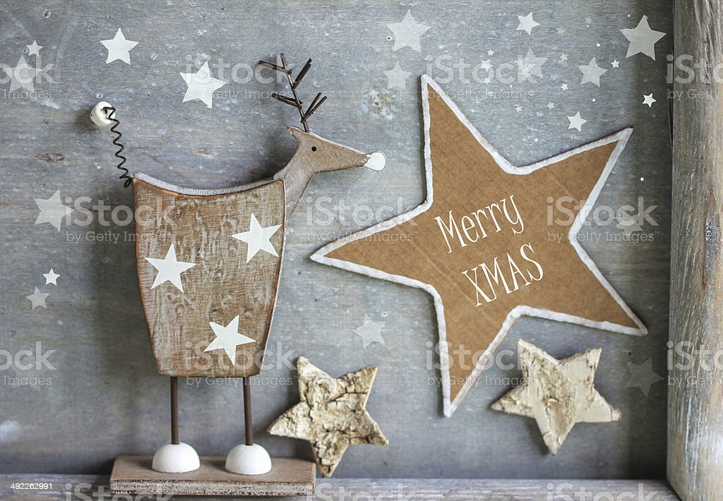 Christmas concept, reindeer on wooden background stock photo
