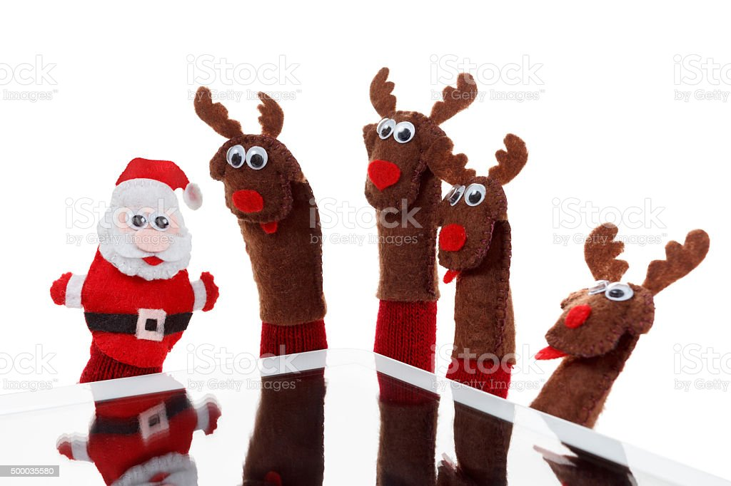 Christmas concept toy Santa, reindeer with gift in hand touchpad stock photo