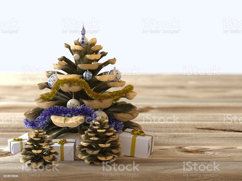 Christmas cone with gifts on wood texture stock photo