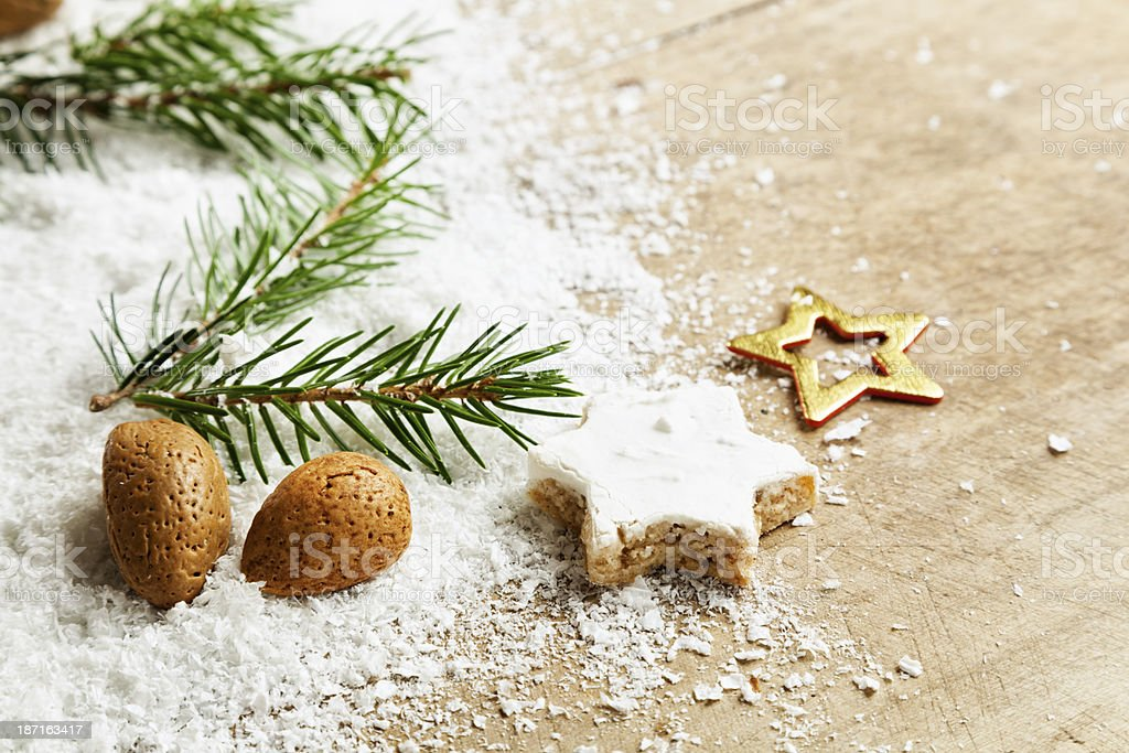 christmas cookie and almond on snow wood stock photo