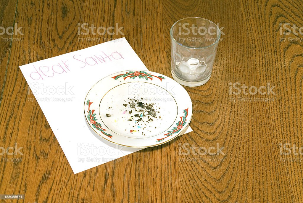 Christmas Cookie Crumbs and Empty Milk Glass on Table royalty-free stock photo