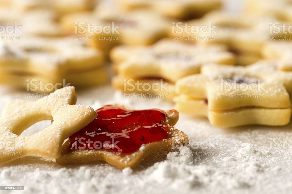 Christmas cookie stars with strawberry jam royalty-free stock photo