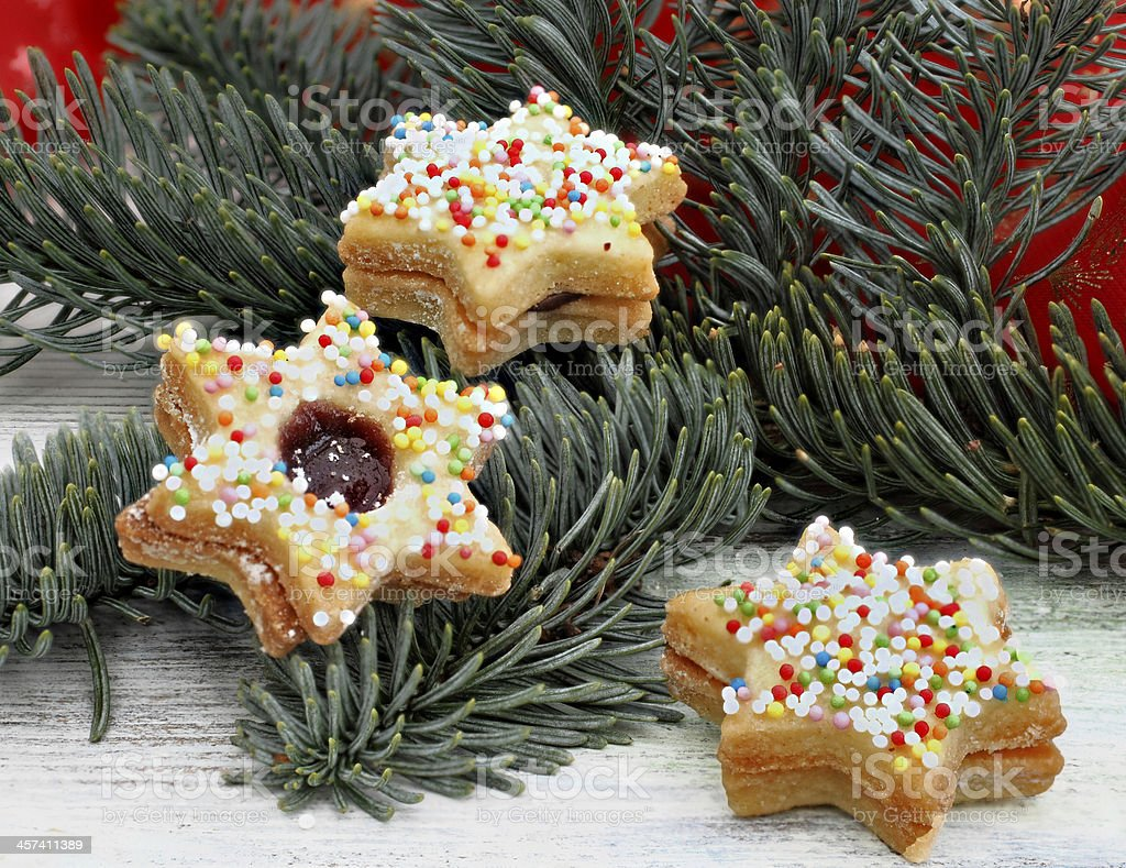 Christmas cookies colorful on a pine branch royalty-free stock photo