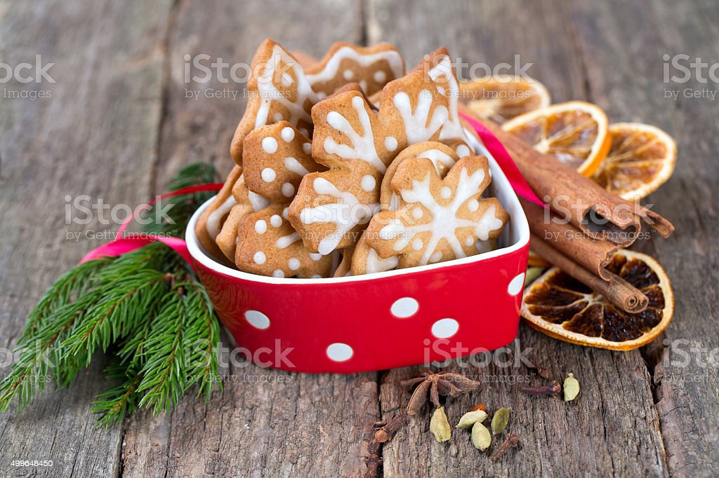 Christmas cookies in a beautiful red bowl stock photo