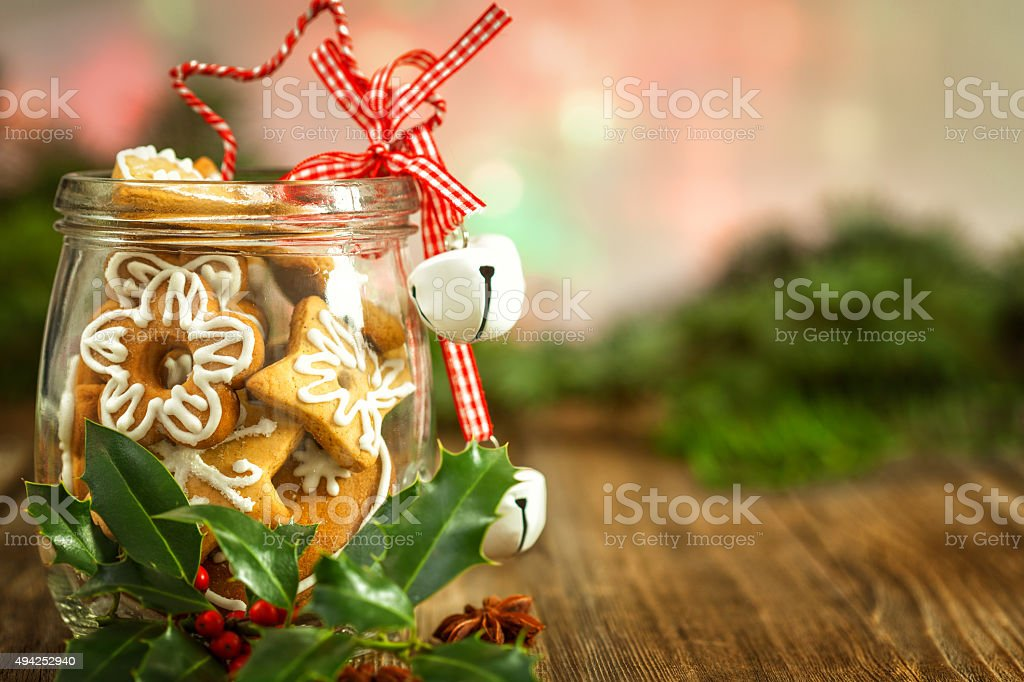 Christmas Cookies in a jar  with Christmas Holly stock photo