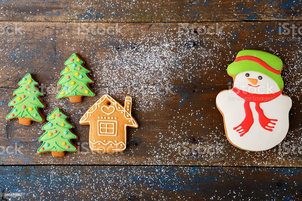 Christmas cookies in the shape of snowman, house and tree stock photo