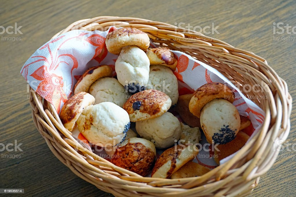 Christmas cookies mushrooms in a basket on a wooden table stock photo