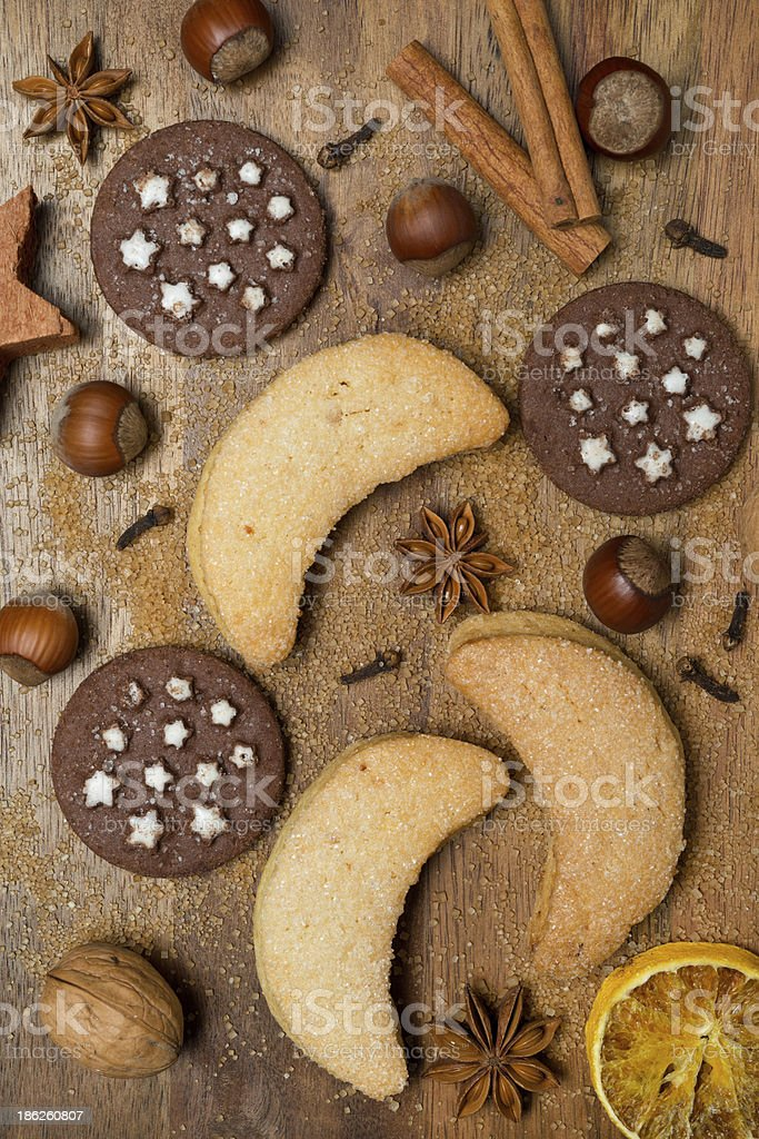 Christmas cookies, spices and nuts on a wooden background royalty-free stock photo
