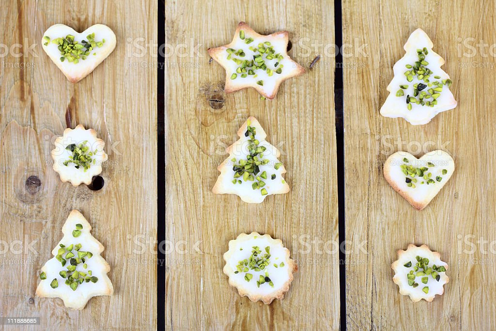 Christmas Cookies with Butter and Pistachio on Wood stock photo