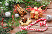 Christmas cookies with decoration on wooden background