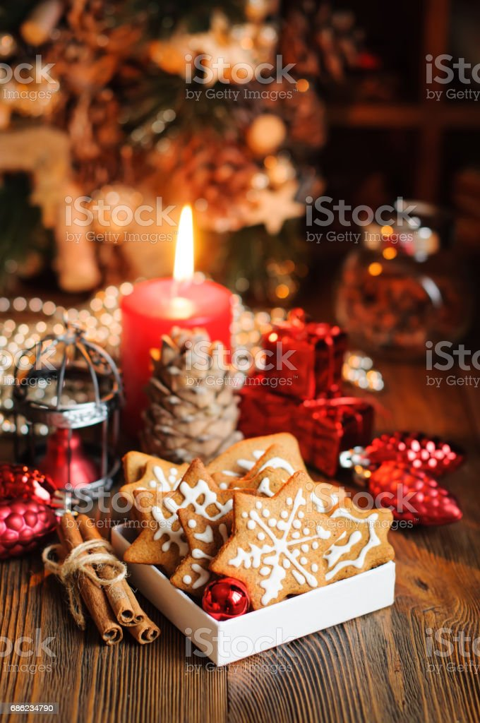 Christmas cookies with decorations on wooden table stock photo