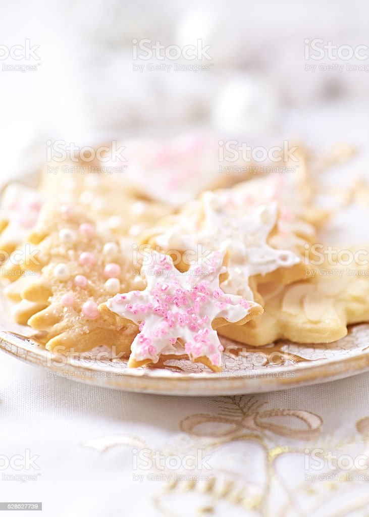 Christmas cookies with icing and sugar pearls stock photo