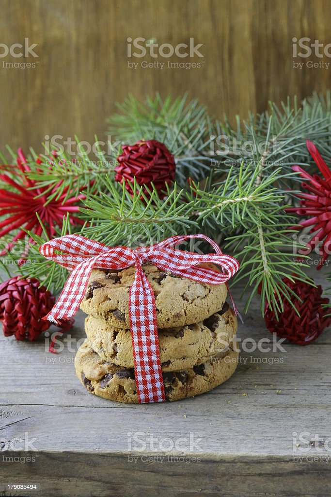 Christmas cookies with red ribbon and green fir tree  branches royalty-free stock photo