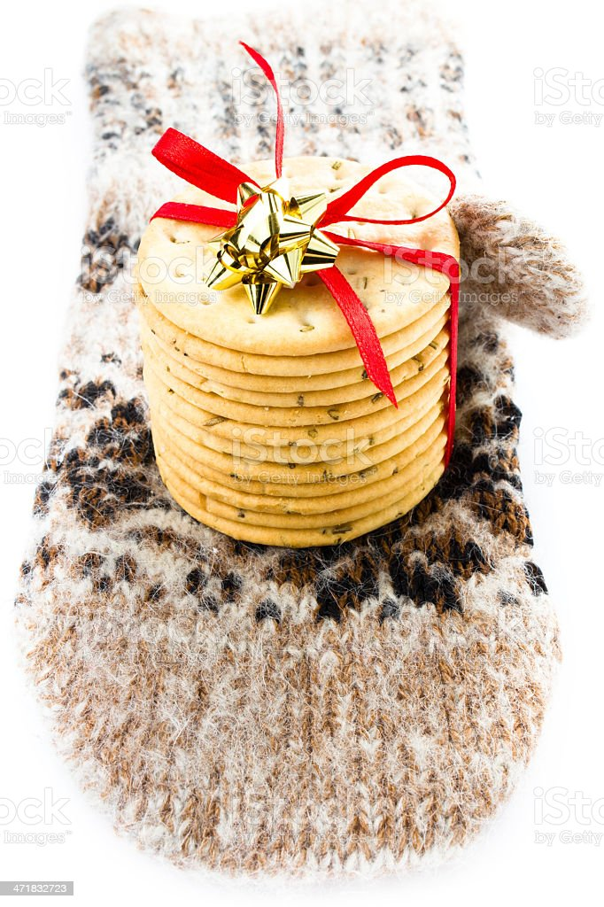 Christmas cookies with red ribbon and knitted mitten royalty-free stock photo