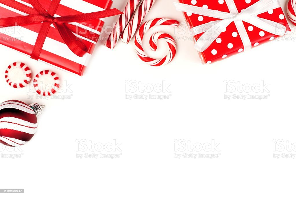 Christmas corner border of red and white gifts and candies stock photo