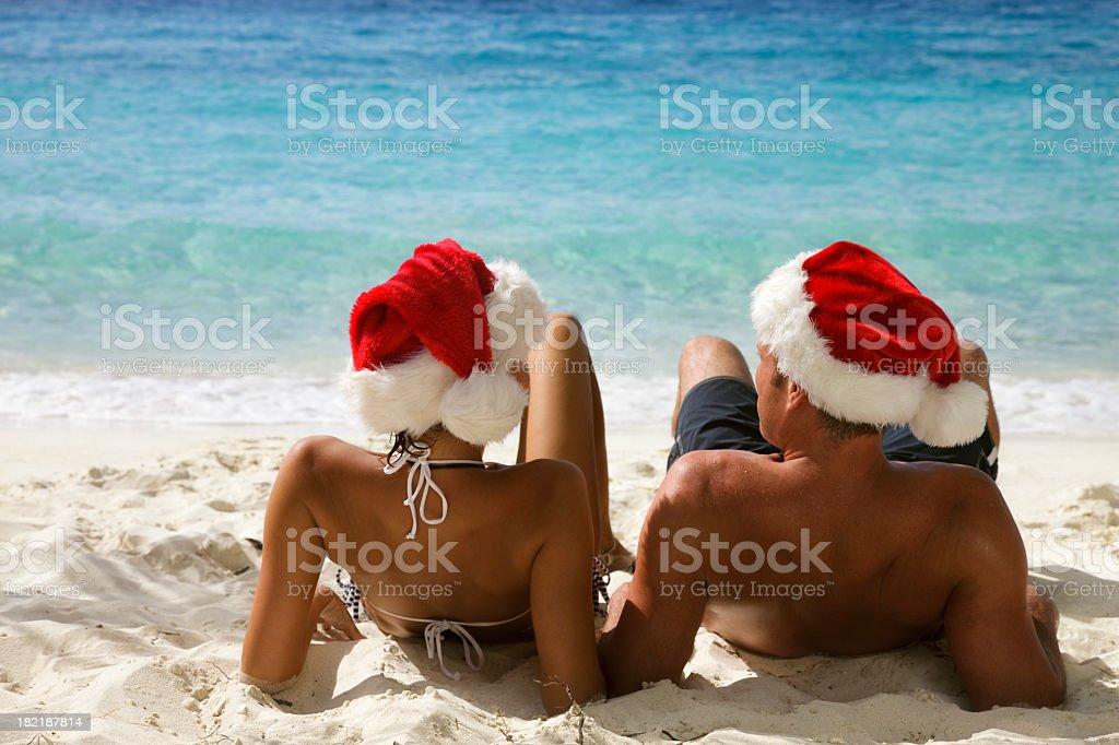 Christmas couple on beach royalty-free stock photo