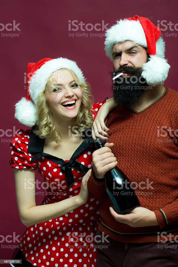 Christmas couple with bottle and cigarette stock photo