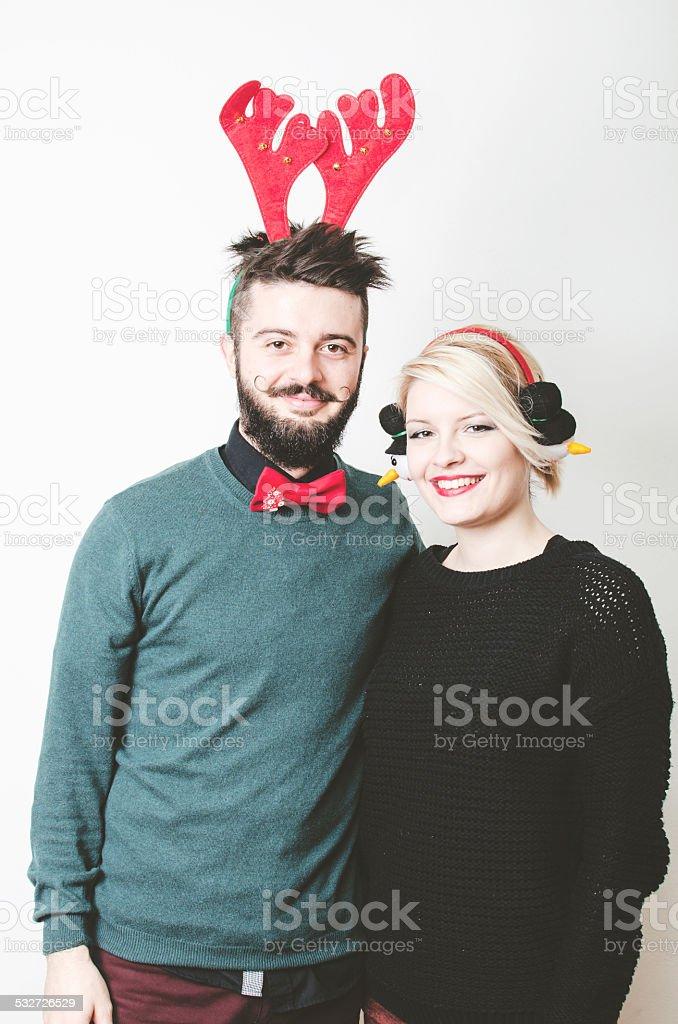 Christmas Couple.Celebrating New Year. Goofing around. Silly masks. stock photo