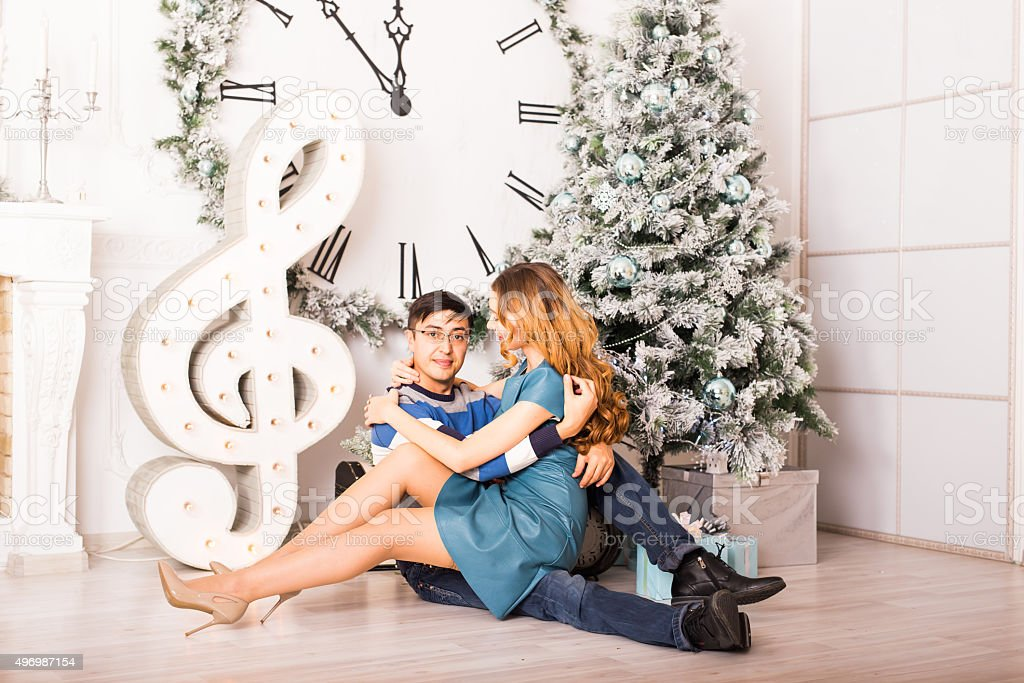 Christmas Couple.Happy Smiling Family at home celebrating.New Year stock photo