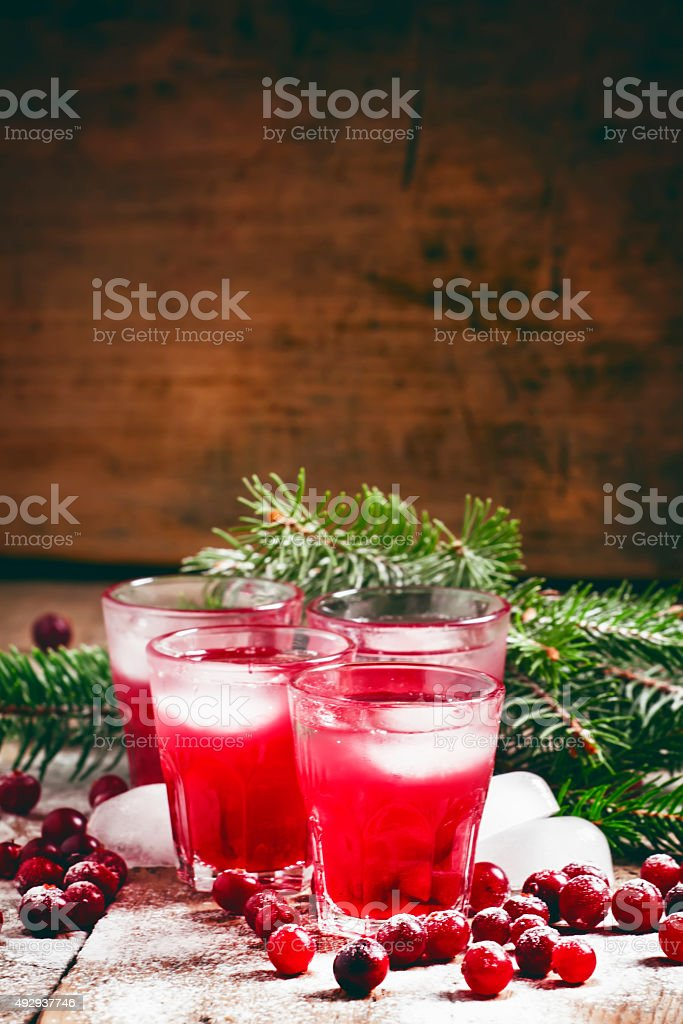 Christmas cranberry cocktail with ice stock photo