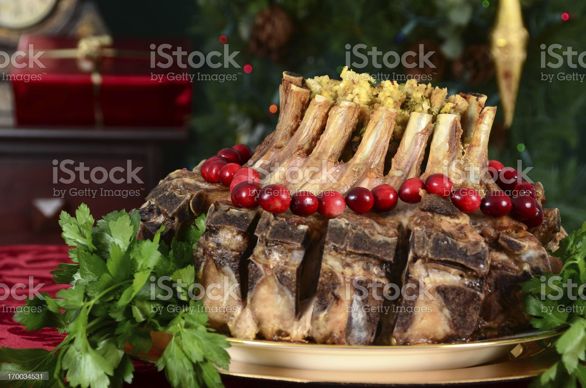 A Christmas crown roast of pork meal in festive background royalty-free stock photo