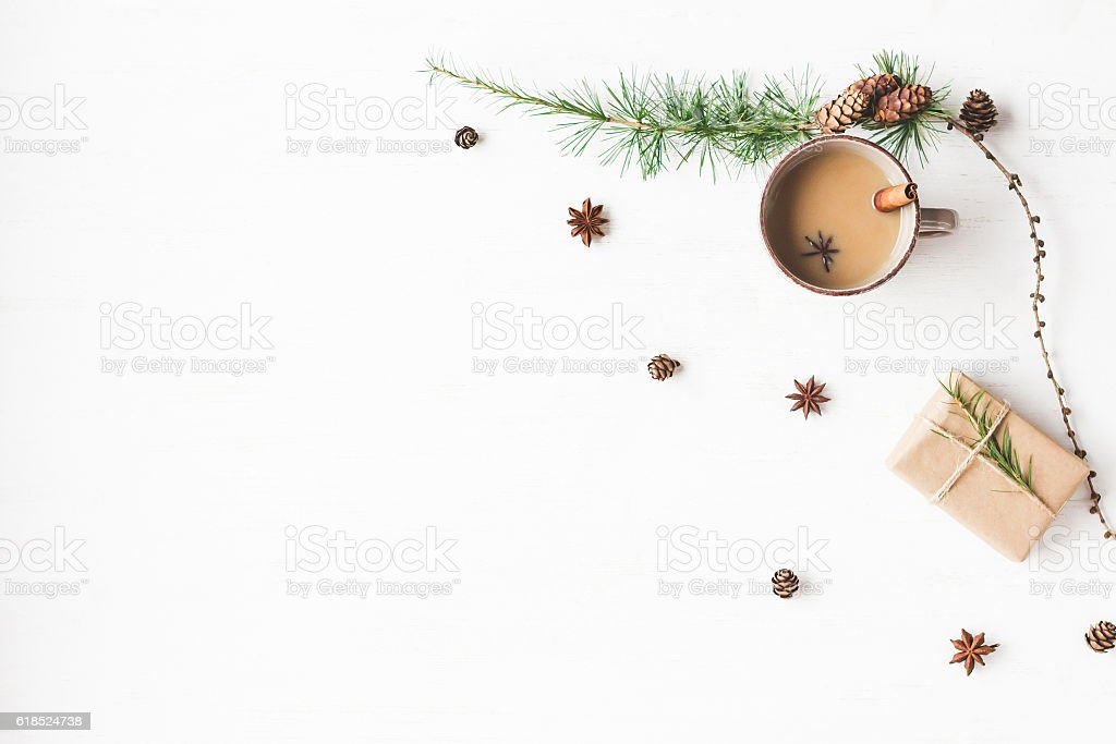 Christmas. Cup of coffee, larch branches, cinnamon sticks, anise star stock photo