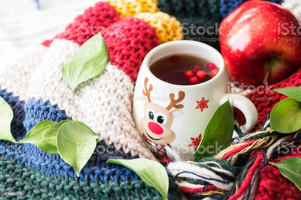 christmas cup of tea with berries stock photo