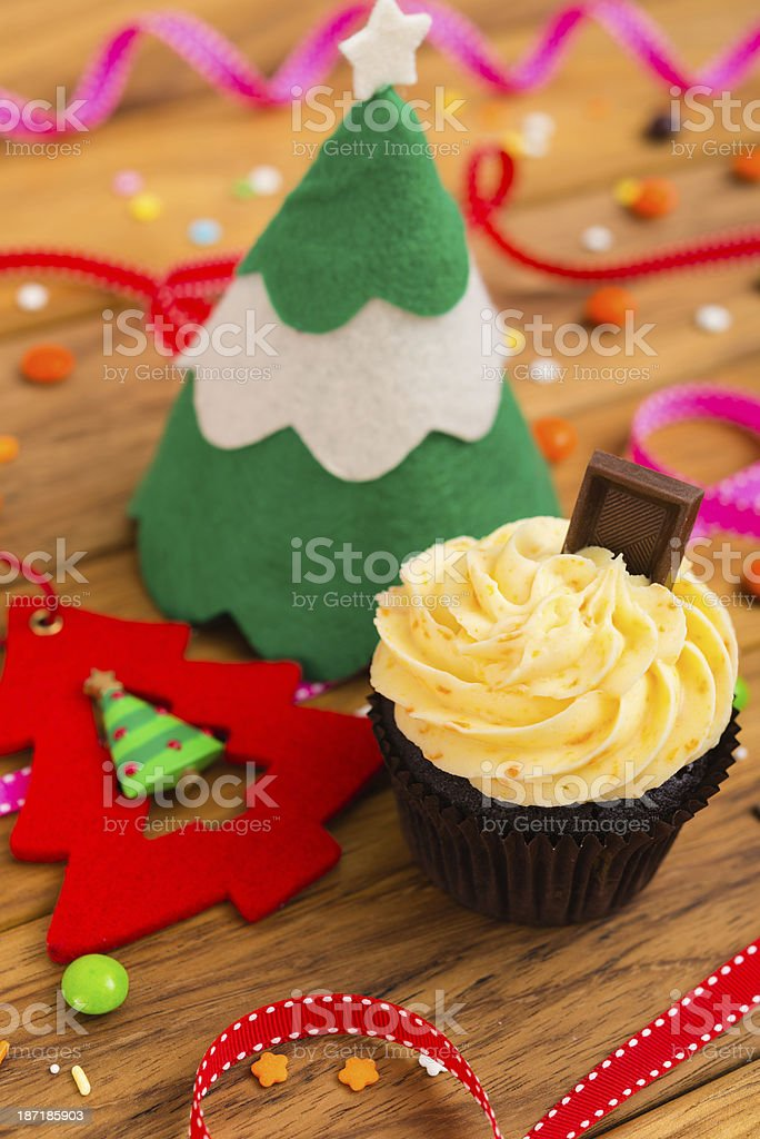 Christmas cupcake on old wooden background royalty-free stock photo