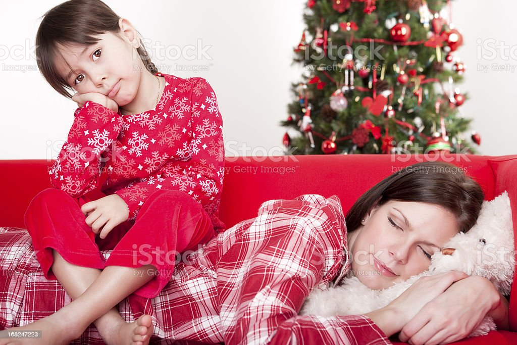 Christmas - Daughter sitting on mother's back royalty-free stock photo