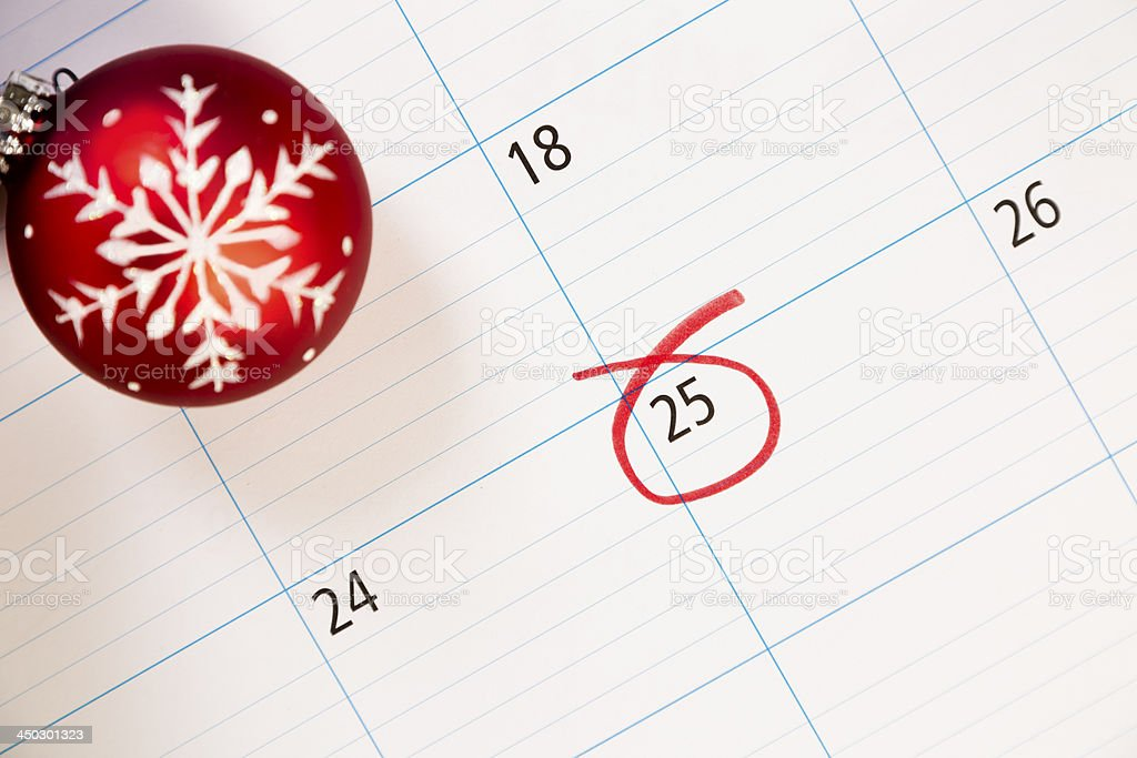 Christmas:  December calendar with focus on the 25th.  Ornament. royalty-free stock photo