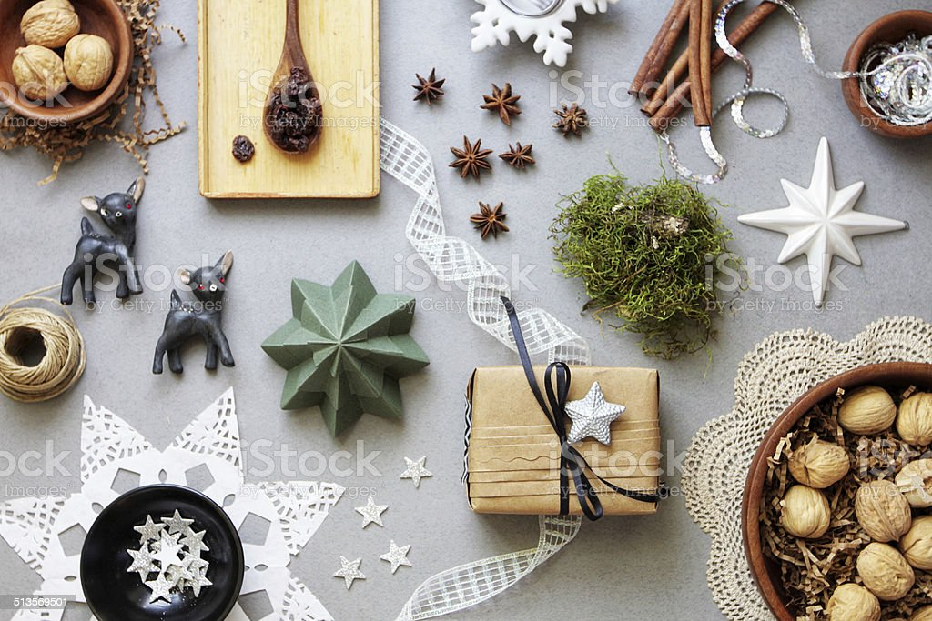 Christmas decor, craft and food on grey paper from above stock photo