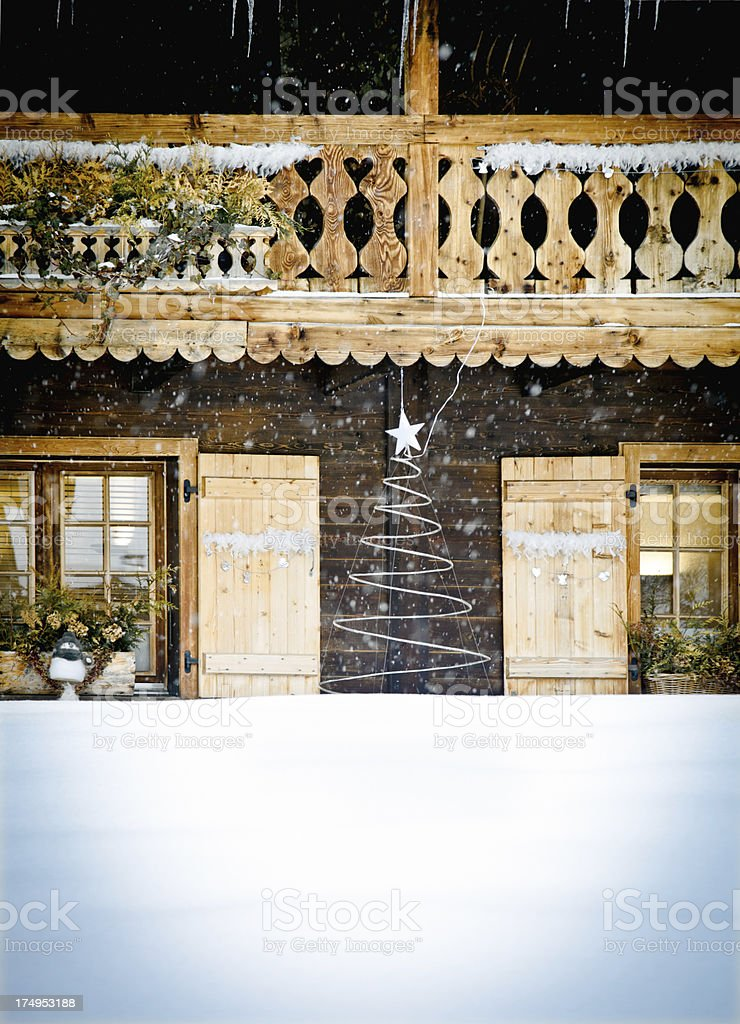 Christmas decorated log cabin entrance stock photo