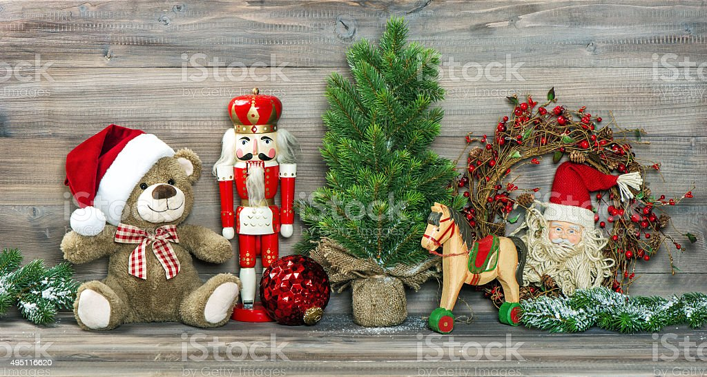 Christmas decoration. Antique toys Teddy Bear and Nutcracker stock photo