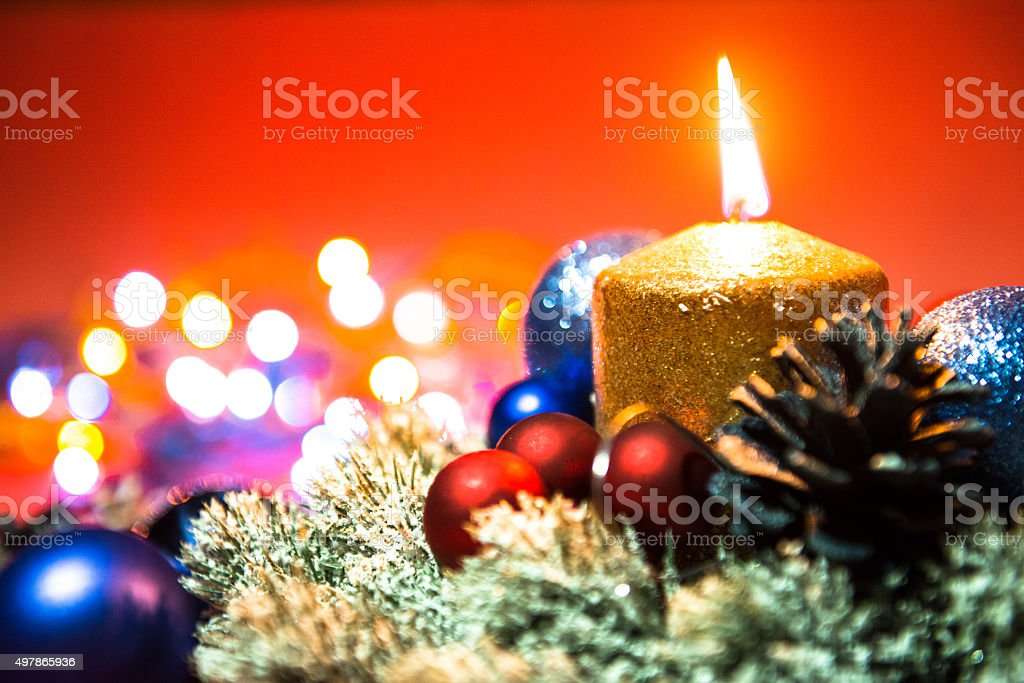 Christmas decoration, baubles, candle and sparkling lights on Christmas night stock photo