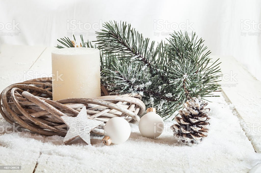 Christmas decoration, candle, artificial snow, twigs, cone, baub stock photo