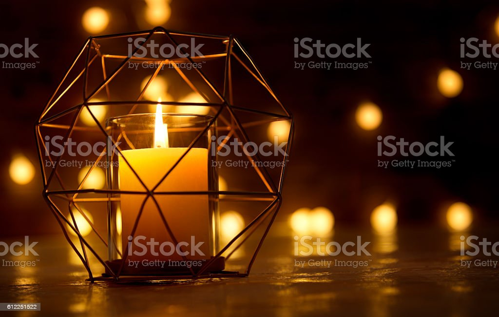 Christmas decoration – candlelight with polygon candlestick stock photo