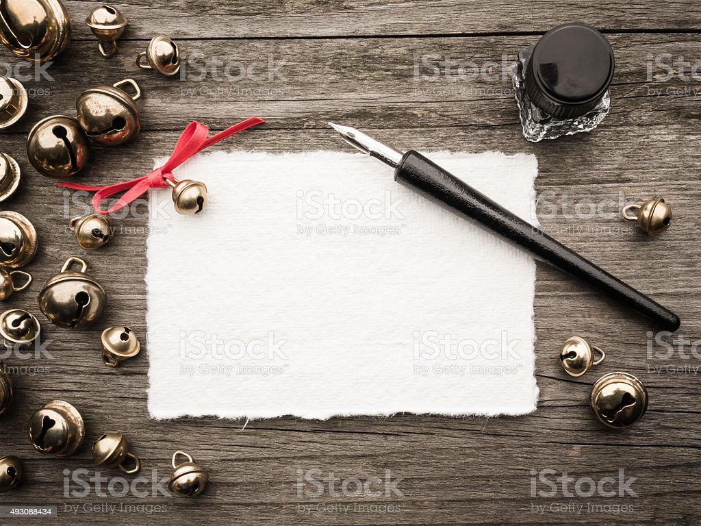 Christmas decoration, card, inkwell, quill and bells stock photo