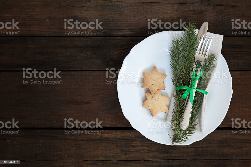 Christmas decoration cutlery on old wooden brown background stock photo