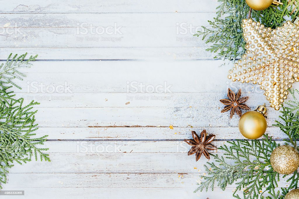 Christmas decoration. Golden balls, star and fir tree branches o stock photo