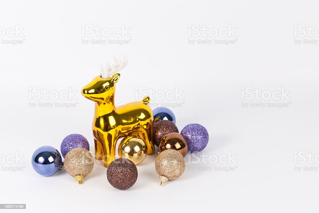 christmas decoration : Golden reindeer with luxary colorful ball stock photo