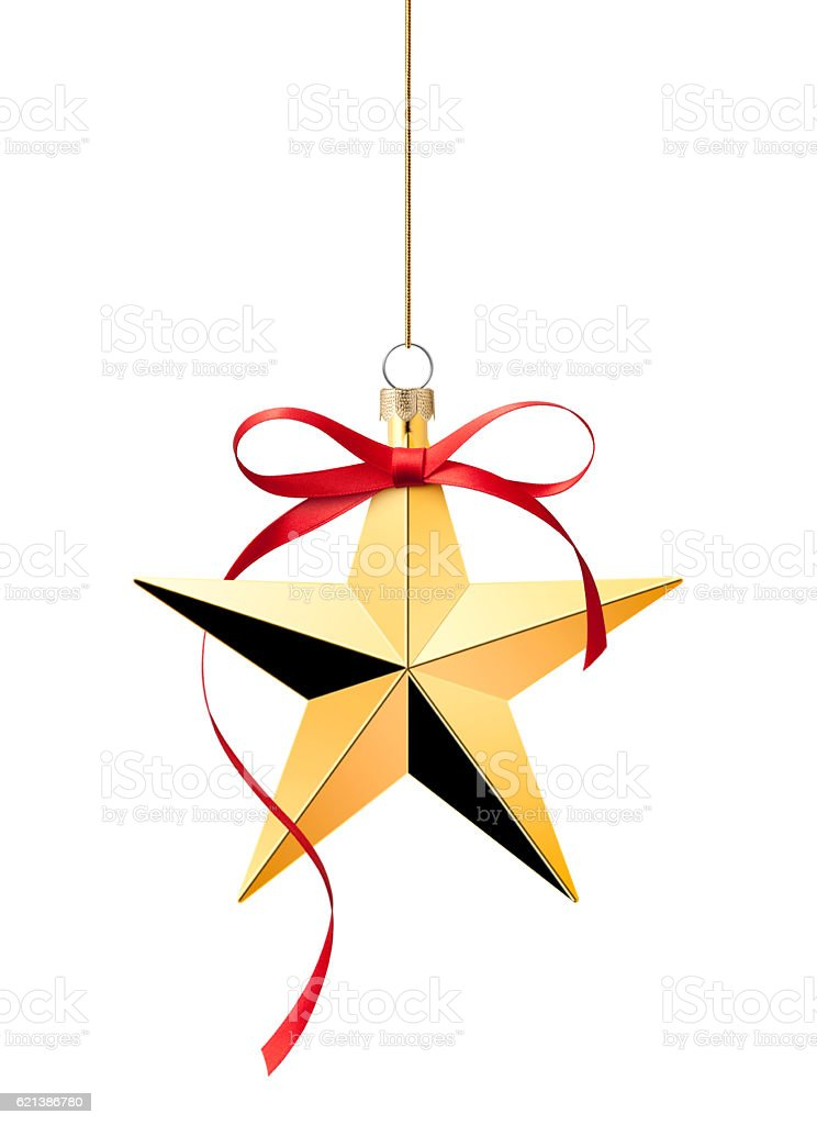 Christmas decoration. Golden star with red bow. stock photo