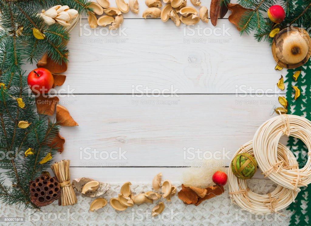 Christmas decoration handmade frame on white wood background copy space stock photo