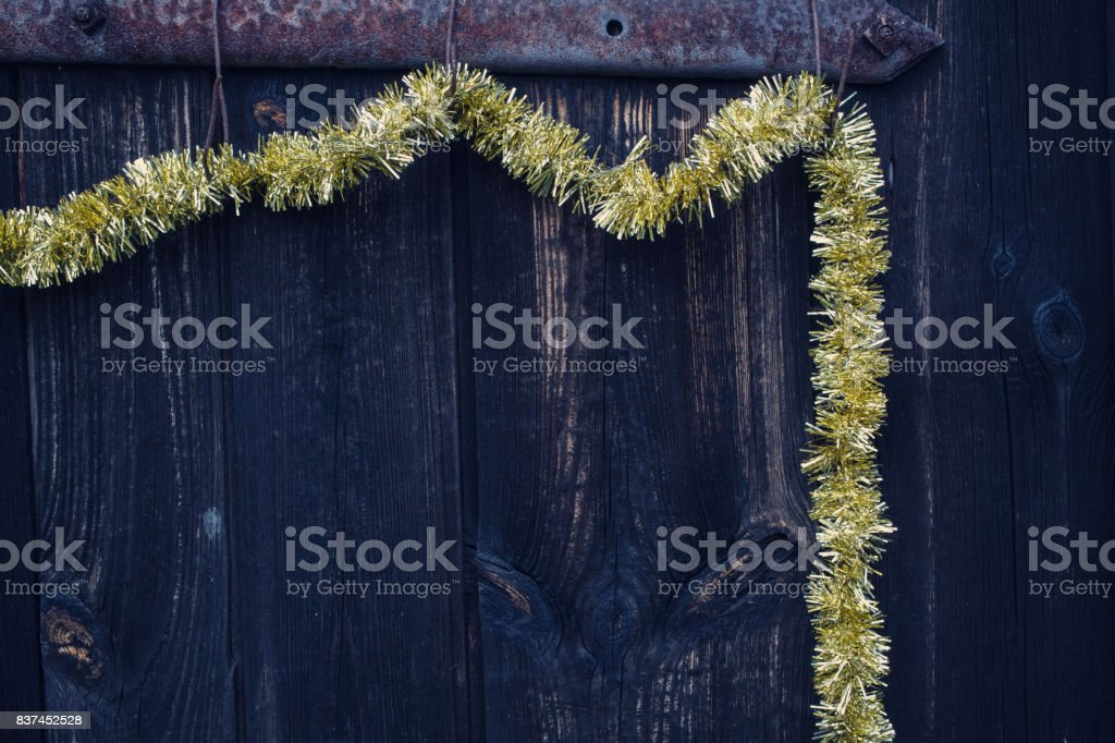 Christmas decoration hanging on the old wooden door. stock photo