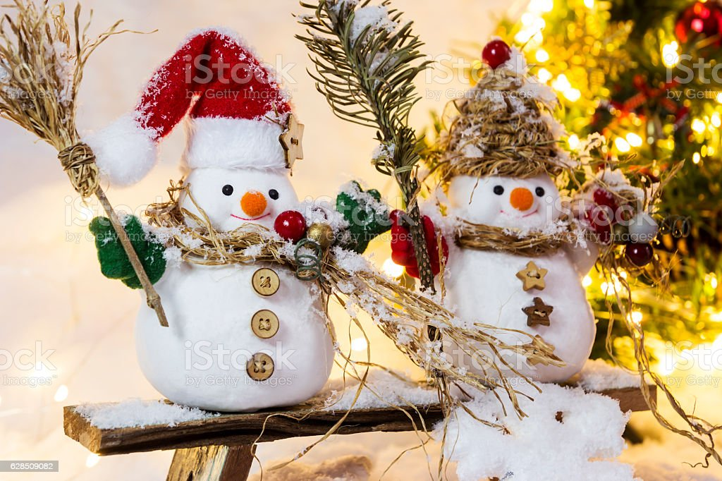 Christmas decoration happy couple snowman standing on the chair stock photo