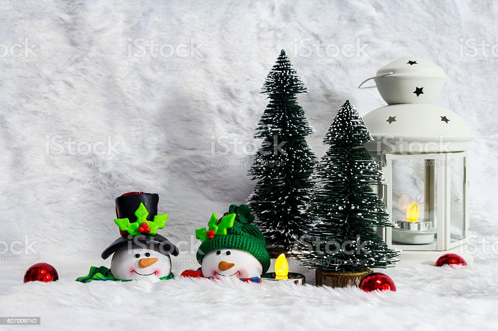 Christmas decoration of couple snowman and pine tree stock photo