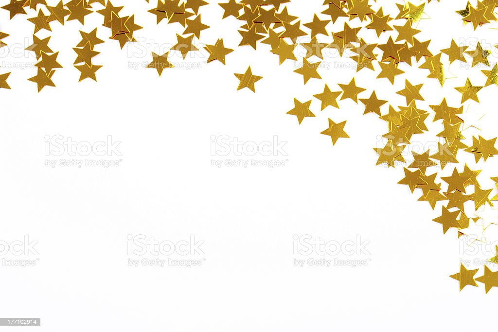 Christmas decoration of golden confetti stars stock photo