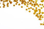 Christmas decoration of golden confetti stars