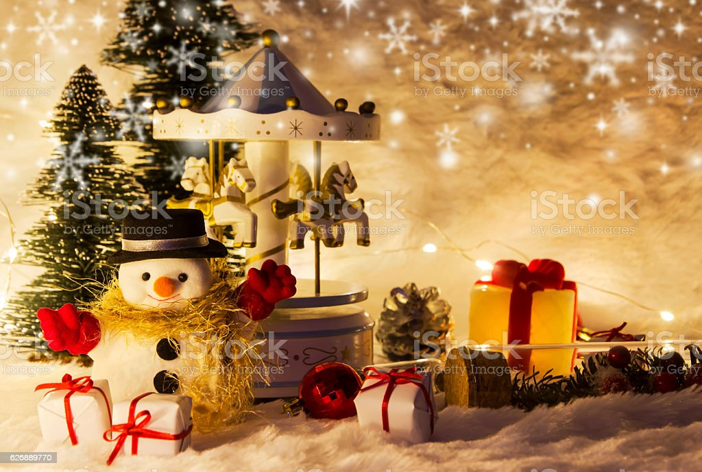 Christmas decoration of snowman and carousel horse stock photo