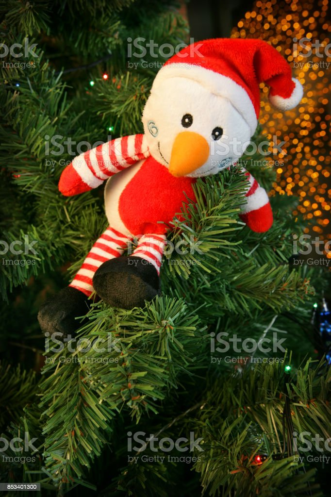 Christmas decoration (funny snowman) on a fir tree branch stock photo